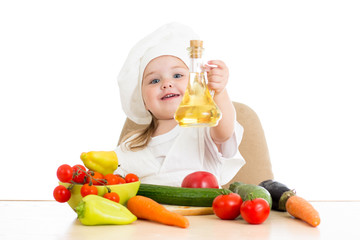 cute girl with healthy food vegetables and sunflower oil