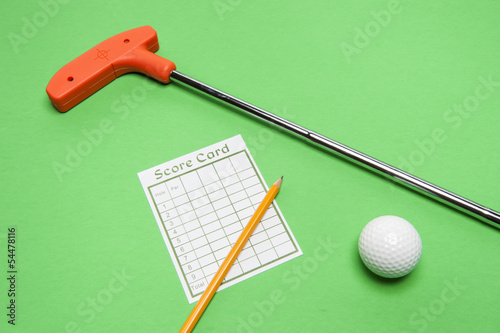 Mini Golf club with score card, ball and pencil
