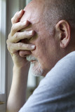 Older man expressing pain or depression, vertical