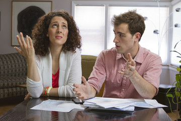 Couple frustrated with paying bills, horizontal