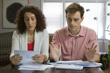 Couple unhappy paying bills, horizontal