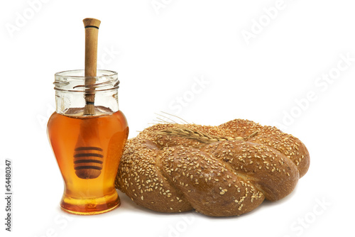Honey and bread on white background