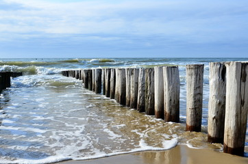 breakwaters on the beach at the north sea in Domburg Holland