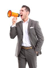 Business man shouting through megaphone