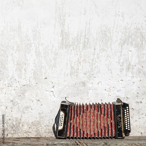 wall and accordion on the bench
