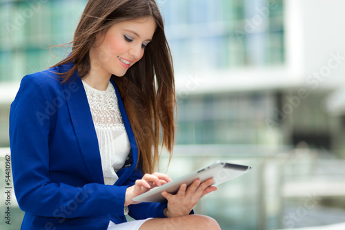 Beautiful businessman using a tablet outdoor