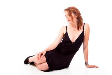 Sad young woman reclining