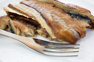 Close view herring fillets on plate