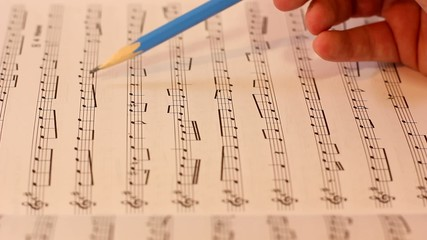 reading and checking musical notes