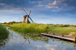 windmill reflected in river