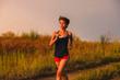 beautiful a healthy runs young brunette woman athlete running ou
