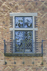Tudor Style Windows with Balcony