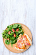 Pizza with salad dinner on rustic background, overhead