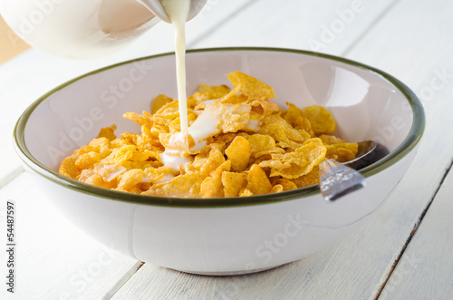 Milk Pouring on Cornflakes