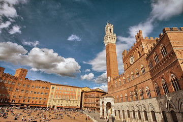 SIENA, ITALY - APR 6: Tourists walk in Piazza del Campo, April 6