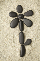 Flower of pebbles on the sand