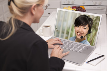 Woman In Kitchen Using Laptop - Online with Nurse or Doctor