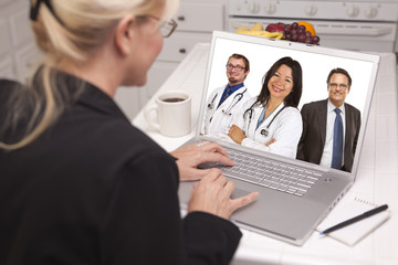 Blonde Woman Using Laptop, Online with Nurses or Doctors
