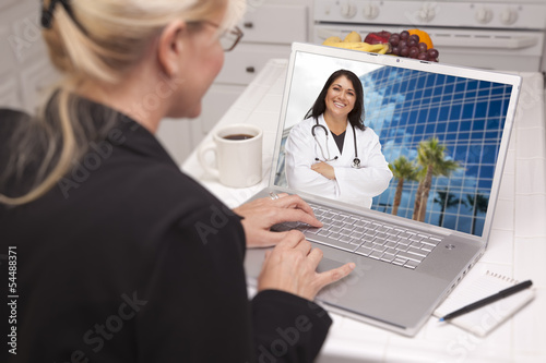 Woman Using Laptop - Online with Nurse or Doctor