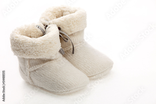 Pair of baby booties over white