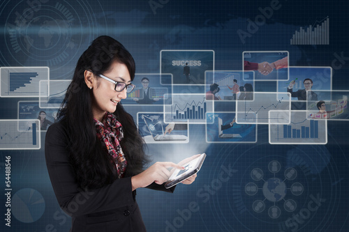 Businesswoman using tablet for working