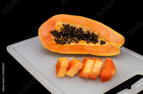 Sweet papaya  isolated on black.