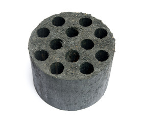 new coal briquette on a white background