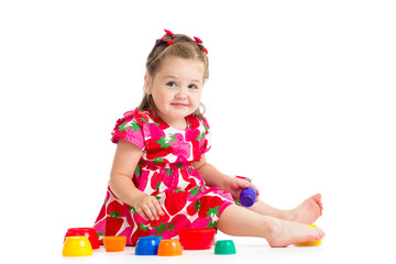 baby girl playing with cup toys, isolated over white