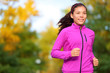 Running woman jogging in autumn forest in fall