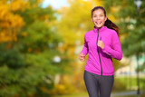 Female jogger - young woman jogging in the park