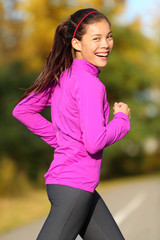 Asian woman running - female runner in autumn