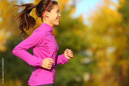 Woman running in autumn fall forest