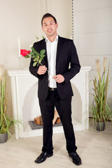 Romantic suitor carrying a red rose
