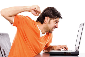 Angry young man at laptop