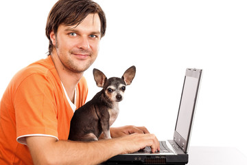 Smilling young man sitting with his cute chihuahua dog in front