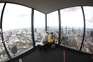 Tourists looking at Melbourne Skyline at Eureka tower
