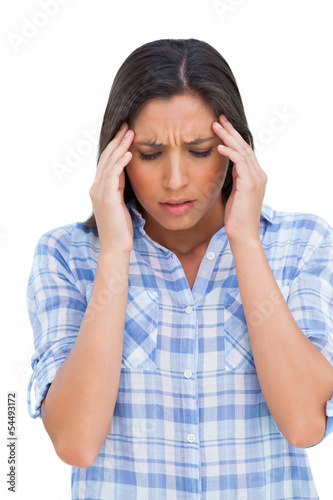 Woman with a headache rubbing her temples