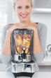 Blonde woman leaning on her juicer
