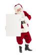 Portrait Of Santa Claus Holding Blank Banner