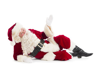 Portrait Of Santa Claus Gesturing While Lying On Floor
