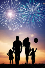 Happy family looking the fireworks