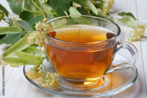 Cup of linden tea on wooden table still life
