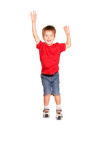 Happy little boy jumping. Isolated on white