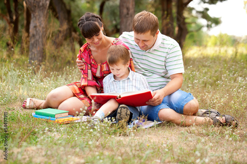 Happy family reading together.