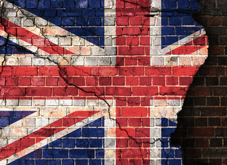 UK flag on a cracked brick wall