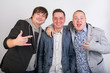 Three smiling stylish gay friend