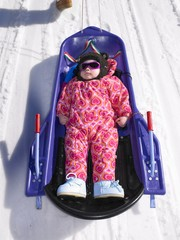 child lying down in sledge