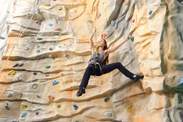 woman on rock wall