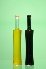 Two closed bottles of olive oil