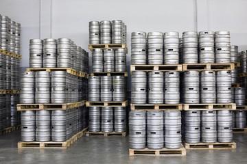 Pallets of beer kegs in stock brewery